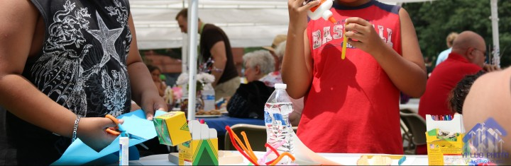 Young residents enjoy bubbles and crafts at the PoCo block party